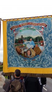 Durham NUM banner. That's Tony Ben addressing the Durham Miners Gala