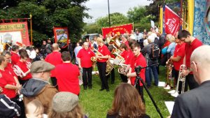 UNITE Brass Band plays a moving send-off before the short march to the Winter Green